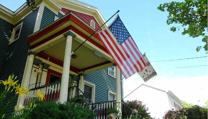 Real Property House with flags