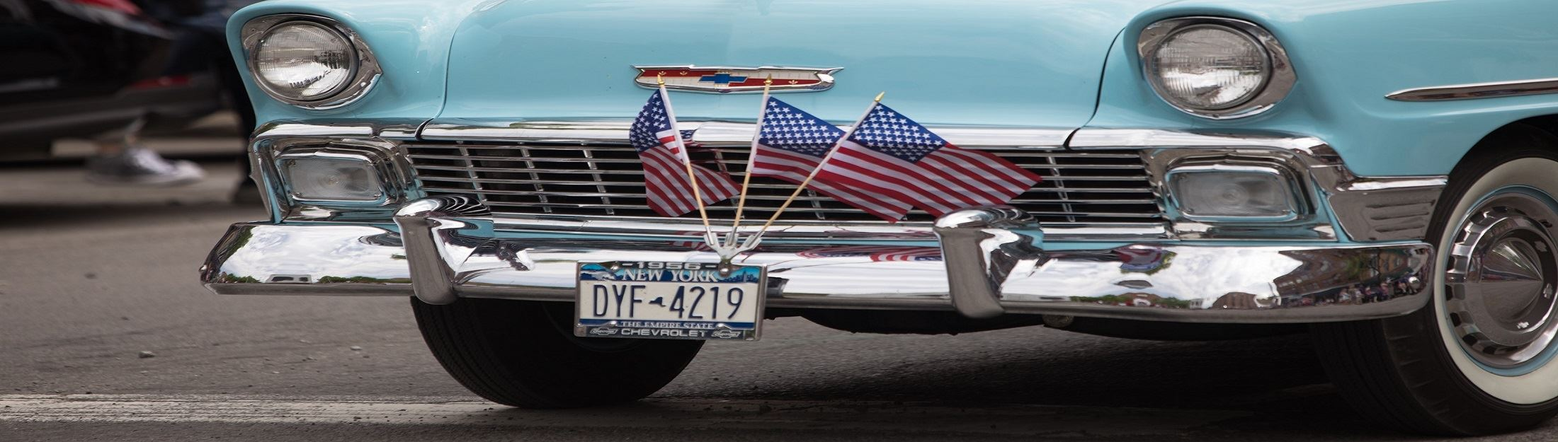 American Flags On Front Of Car by Tourism Office