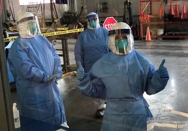 Health Department Workers in protective gear