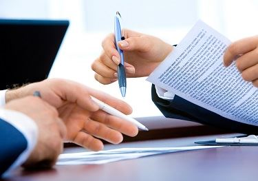 Hands Pointing At Papers With Pens